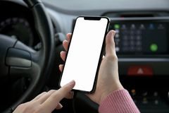 Women hand holding phone with  screen in the car Stock Photo