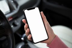 Women hand holding phone with  screen in the car Stock Images