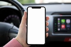 Women hand holding phone with  screen in the car Stock Image