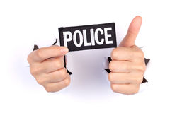 Women Hand Holding Police Flag Royalty Free Stock Image