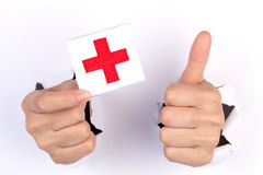 Women Hand Holding Red Cross Flag Royalty Free Stock Image