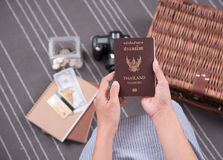 women hand holding Thailand travel passport with camera, money b Stock Photography