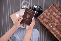 Women hand holding Thailand travel passport with camera Stock Images