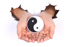 Women Hand Holding Yin Yang Flag stock photography
