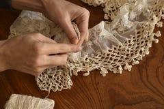 Women hand knitting scarf Royalty Free Stock Image