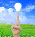 Women hand with Light bulb Stock Photo