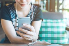 Women hand are listening to music from mobile phones. Royalty Free Stock Photography