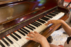 Women Hand playing antique piano classic Royalty Free Stock Image
