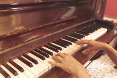 Women Hand playing antique piano classic Royalty Free Stock Photography