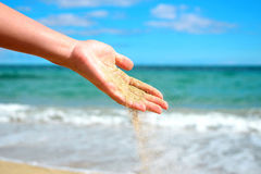 Women hand with sand falling Royalty Free Stock Photos