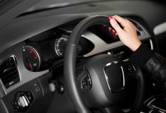 Women hand on the steering wheel Royalty Free Stock Photos