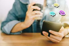 Women hand using smartphone typing conversation in chat box icons pop up. Women hand using smartphone typing, chatting conversation in chat box icons pop up royalty free stock images