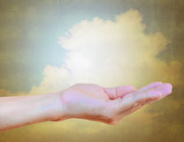 Women hand on vintage sky background Royalty Free Stock Photos