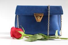 Women handbag with rose Stock Photos