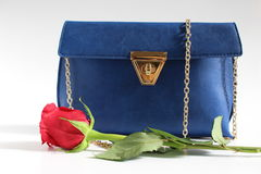 Women handbag with rose. Women blue handbag and red rose Stock Photos