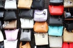 Women handbags hanging on wall in market Royalty Free Stock Photos