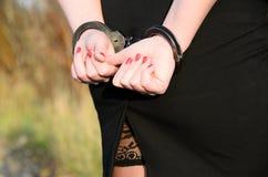 Women handcuffed criminal police. Photo of women handcuffed criminal police Stock Photo
