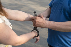Women handcuffed criminal police Royalty Free Stock Image