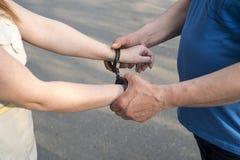 Women handcuffed criminal police Stock Photo