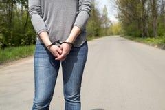 Women handcuffed criminal police Stock Photography