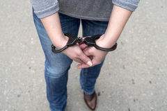 Women handcuffed criminal police Stock Photos