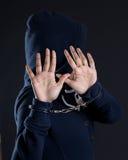Women in handcuffs avoiding photographer