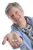 Woman handing out medicines Royalty Free Stock Photo