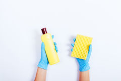 Women hands in blue rubber gloves holding a yellow bottle of det Royalty Free Stock Photos