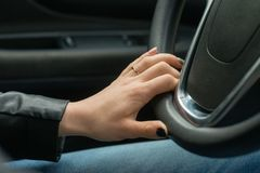 Women hands on the car`s steering wheel. Women hands on the car`s steering wheel Stock Photography