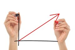 Women hands drawing a growth graph. Ic in the air with a marker with a white isolated background Stock Photo