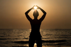 Women Hands Forming A Heart With Sunset Silhouette Royalty Free Stock Image