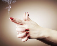 Women hands or gun with smoke, concept Royalty Free Stock Photo