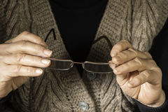 Women hands hold glasses. Old women hands hold glasses Stock Photography