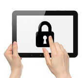 Women hands hold and touch tablet PC with lock Royalty Free Stock Photography