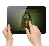 Women hands hold and touch tablet PC with lock Stock Images