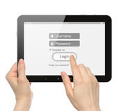 Women hands hold and touch tablet PC with login box Stock Image