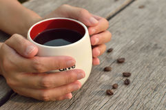 Women  hands holding a coffee cup. Women  hands holding a hot coffee cup Royalty Free Stock Photos