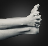 Women hands holding the leg Royalty Free Stock Images