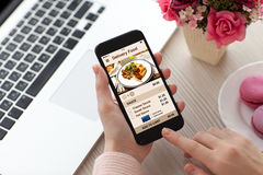 Women hands holding phone with app delivery food on screen royalty free stock photo