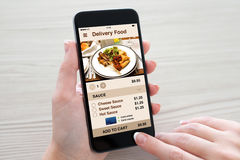 Women hands holding phone with app delivery food on screen stock photo