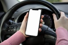 Women hands holding phone with  screen in the car Royalty Free Stock Images