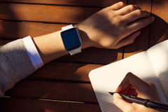 Women Hands with smart watch Royalty Free Stock Image