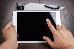 Women hands with tablet computer on table Royalty Free Stock Images