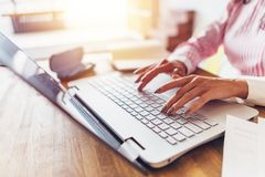 Women hands typing on the keyboard Work at home. Women hands typing on the keyboard Work at home stock photos