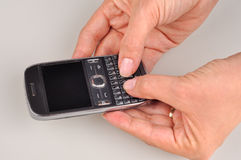 Women hands using a PDA mobile phone, blank screen Stock Photos