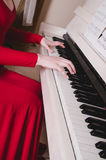 Women hands on white keyboard piano, playing melody. Concept music Stock Photo