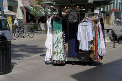 For Women Only. Hanged on a rolling store kiosk the different styles and color of the women's dresses for sell Royalty Free Stock Photography