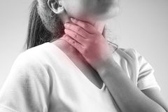 Women has neck pain, illness concept in black and white stock images