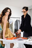 Women in haute couture sui. Woman in fashion atelier haute couture Royalty Free Stock Image