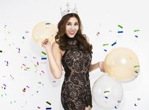 Women have fun and enjoyment in the happy new year party. With balloon decoration on white background royalty free stock images